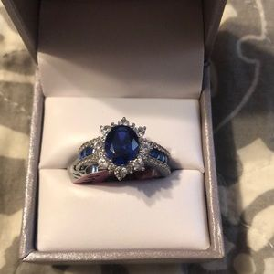 Blue and white sapphire oval halo